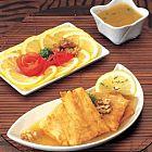 سمك بصلصة الليمون الحامض والجوز