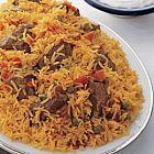 الأرز مع لحم الغنم والطماطم والبازيلا